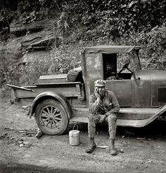 """by Marion Post Wolcott """"Miner waiting for ride home. Each miner pays twenty-five cents a week to owner of car."""" Capels, West Virginia, Septe..."""