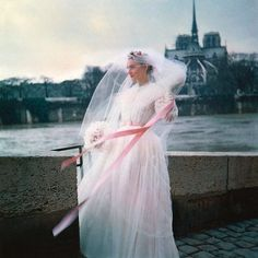 """""""Mi piace"""": 3,020, commenti: 25 - This Was Fashion (@thiswasfashion) su Instagram: """"Model wearing Jacques Griffe wedding dress with pink sash, with Norte Dame Carhedral and the Seine…"""""""