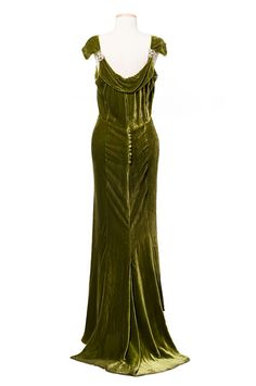 https://flic.kr/p/bqbnRT | Dress (with jacket), 1930s, McAvoy of Chicago | Olive green silk velvet dress and jacket, 1930s. The dress has a boat neckline, rhinestone shoulder clips and a short train in back. It has a long sleeved jacket with batwing sleeves. The bias cut adds stretch and drape to the lustrous fabric. It was worn by Miss Fanny Eliza Hume (1882-1950) of Charleston and bears a McAvoy/Chicago label. From the collections of the Charleston Museum, Charleston, South Carolina.