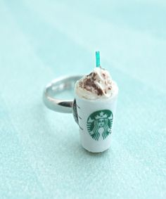 Starbucks Frappuccino Ring this ring features a miniature starbucks frappucino drink. it measures about cm tall it is securely attached to an adjustable silver tone ring that fits most ring sizes. Starbucks Frappuccino, Starbucks Drinks, Starbucks Coffee, My Coffee, Coffee Drinks, Starbucks Crafts, Starbucks Clothes, Accesorios Casual, Secret Menu