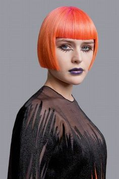 Straight red hair in cropped bob with blunt fringe by Fudge. Hair: Strangeways Artistic Team for Fudge Colour and Products: Fudge Photography: The LaRoache Brothers Clothes Styling: Karen Binns Makeup: Nadia Braz