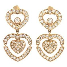 A pair of new 18k rose gold earrings set with approximately 0.73ctw of F/VVS diamonds. Crafted by Chopard, the earrings measure 21mm long x 12mm wide. The bottom heart elements are movable. Come with