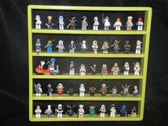 This shelf has BLACK 2 x 2 round legos plates Painted gloss citrus green solid pine mini figure display shelf hold 50 mini figures, 10 figures