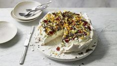 Glacé cherries, pistachios and mixed peel give this pavlova a decadently rich flavour that's a bit different to the usual fresh fruit. Tutti Frutti, Nadiya Hussain Recipes, Cake Recipes, Dessert Recipes, Bbc Recipes, Frozen Cheesecake, Pavlova Recipe, Baked Strawberries, Chocolate Shavings