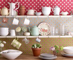 Different wallpaper on each shelf-- all polka dots!