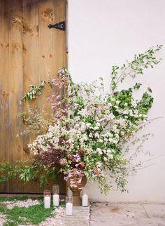 Ivy and Honor // Steeplechase Wedding // Maryland Wedding // Equestrian // Tall ceremony flower arrangement dogwoods greenery purple yellow green bar doors