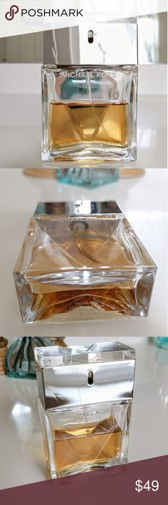 Michael Kors Perfume 1.7 oz. size. About 1 ounce is left. Authentic Michael Kors, purchased at Macy's. Bottle and spray top are in excellent condition other than minor scratches on the front silver plate, shown in third pic. Michael Kors Other
