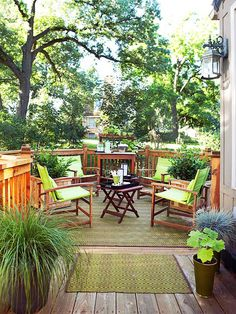 Create a color theme to give your deck a new look without spending a lot of money. Here, lime-green chair cushions coordinate with an outdoor-friendly rug and chartreuse plants./