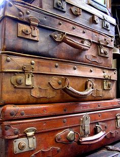 Pile of suitcases    found at the Dongtai Lu Antique Market in Shanghai where bargains abound and a buck goes a long way.  by flyheli on flickr