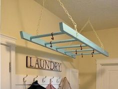 Great idea for clothes that need to hang dry! This would look cute in our garage laudry room!!