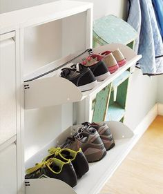 Do you stumble through scattered shoes every time you enter your house? Easy-access cabinets with drop-down doors work like magic.
