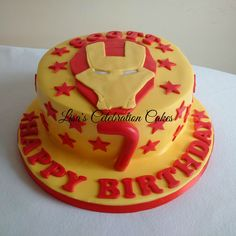 """Yellow ans red simple Iron man themed 8"""" cake"""