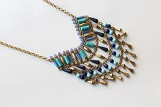 Azul means blue in Spanish and the name of this necklace speaks for itself. Not just because blue is a focal color in the necklace but because this beaded beaut