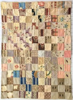 Pretty little one patch quilt made of what looks to be mostly Pre-1850 fabrics