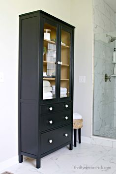 How to paint IKEA furniture. See how I transformed the Hemnes glass door cabinet for our master bath. Cabinet Door Makeover, New Cabinet Doors, Painting Ikea Furniture, Bathroom Furniture, Painted Bathroom Cabinets, Glass Bathroom Cabinet, Bathroom Vanities, Painted Furniture, Furniture Design