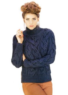 Темно-синий свитер, богато декорированный интересными узорами, от французских дизайнеров. Вязание спицами