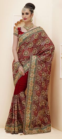 132035: Red and Maroon color family Saree with matching unstitched blouse.