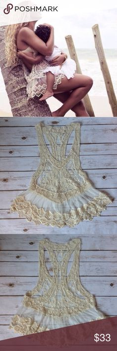 """Crochet and Lace/Mesh Coverup This sexy coverup is perfect over a swimsuit or paired with a cami or crop top as a long top. This listing has a slightly different design than the other one. Actual item shown in last two pics. Approximately 28"""" long lying flat when front and back hems are lined up. Swim Coverups"""