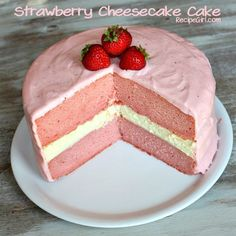 Strawberry Cheesecake Cake - The white layer in the middle is Cheesecake. The frosting is Strawberry Cream Cheese. My keyboard is covered in drool....