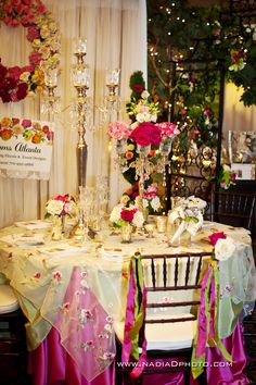 Blossoms Atlanta captured by Nadia D Photography..pink, green and crystals table decor