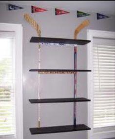 Hockey stick wall shelf