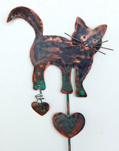 Cat Kitty Feline Yard Art Metal Copper Plant Stake Lawn Ornament Outdoor Patio Garden Spike Decor. $39.95, via Etsy.