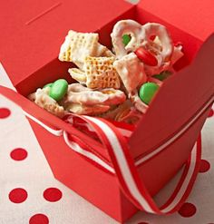 Salty meets sweet as cereal, pretzels and peanuts get a coating of melted white baking pieces. Package this gift from the kitchen in boxes that resemble takeout containers.