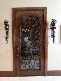 Wine Cellar Door - dark wood, wrought iron and frosted glass (slight arch with wrought iron and glass)