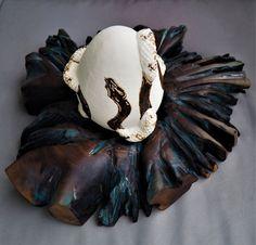 """Sculpture by ALIN RIHOR -""""Nest-Orphic egg"""" limoges porcelain and oak wood."""