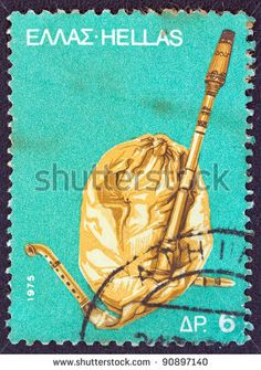 """A stamp printed in Greece from the '""""traditional musical instruments"""" issue shows a bagpipe (gaida), circa 1975 ."""