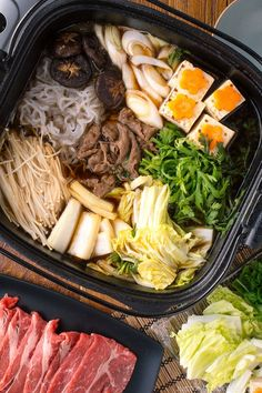 Cozy up at your get-together with friends and family with this homemade Japanese Sukiyaki recipe, served with seared marbled beef and a variety of vegetables cooked in a soy sauce broth. #sukiyaki #hotpot | Easy Japanese Recipes at JustOneCookbook.com