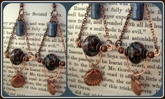 Awesome earrings by Mooby Grace - find them here: http://moobiegracedesigns.blogspot.com/2012/03/lori-andersons-5th-bead-soup-blog-party.html Definitely have to try out this way of adding dangles, I really like how it looks!