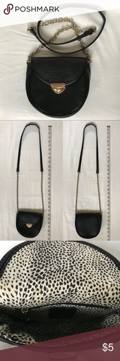 Small Black & Gold Crossbody Purse This cute purse is perfect for those events where you don't want to carry around a big bag all night! 👌🏼 It's light, convenient, & will fit the essentials 😄  Product details:  - 1 zipper pocket inside  - Discoloration on the upper inside of the bag  - Strap is slightly bended at the shoulder  - Small scuffs on the gold buckle Bags Crossbody Bags