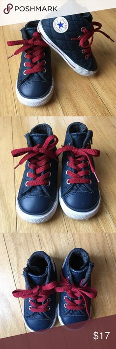 Converse all star high top toddler sneaker size 6 Converse all star high top toddler sneaker size 6. Navy blue with red laces. Quilted pattern and insulated inside. Sis zip and lace ups. Have been worn but are in great shape. Converse Shoes Sneakers