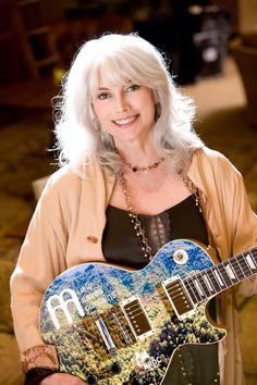 Emmylou with a rather colorful guitar...