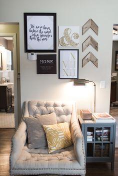 Living Room | Pride & Joyce // gallery wall, chevron, wood arrows, tufted chair, anthropologie, target