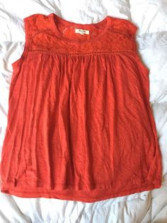 This is a very nice Madewell red lace sleeveless shirt women's size medium. The shirt is red with lace around the chest and shoulders. All measurements are approximate and taken with the shirt laying flat.