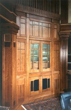 """Craftsman Style Interior Woodwork.   All of the interior woodwork in this house was designed by Robert R. Larsen, A.I.A. to emulate the work of renowned craftsman-era architects Greene & Greene. The millwork is predominently cherry with touches of walnut and maple. Rounded edges, square walnut pegs, and oriental """"cloud-lift"""" elements work together to complete the design which complements the craftsman style exterior architectural expression of the house."""
