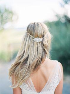 Long, straight wedding hair with a beautiful crystal barrette: http://www.stylemepretty.com/california-weddings/glen-ellen/2014/04/03/soft-romantic-sonoma-winery-wedding/ | Photography: Kristen Wood - http://kristenwood.com/