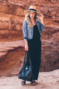 Casual summer outfit with cropped denim jacket, black maxi dress, Birkenstock sandals, and black bucket bag | Meagan's Moda