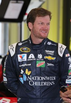 Dale Earnhardt Jr. Photos - Dale Earnhardt Jr., driver of the #88 Nationwide Chevrolet, stands in the garage area during practice for the NASCAR Sprint Cup Series Quaker State 400 at Kentucky Speedway on July 7, 2016 in Sparta, Kentucky. - Kentucky Speedway - Day 2