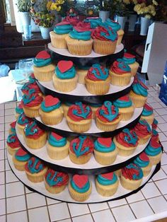 Teal and Red Hearts and Anchors Cupcakes for a Nautical themed Wedding.