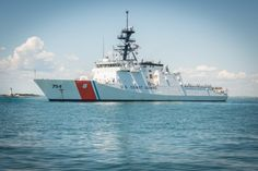 Prior to its commissioning in Boston, US Coast Guard cutter James anchors near Boston Light