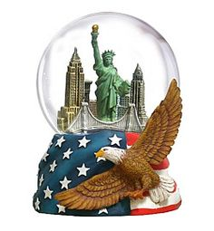 "NYC Skyline Patriotic  Snow Globes     Our NEW Collector's Snow Globe features a NYC skyline and a patriotic base!  Plays ""New York, New York"", the song made famous by Frank Sinatra.     One of NYCwebStore.com's most recent and exciting additions to our snow globe collection. Features the New York City skyline including the Statue of Liberty, Brooklyn Bridge, Empire State Building and Chrysler Building. The patriotic base features an American flag and a bald eagle."