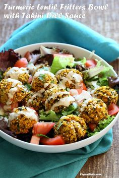 Turmeric Lentil Fritters Tomato Greens Bowl with Tahini Dill Sauce. Baked Seedy Golden Lentil fritters with greens, tomatoes and a tahini sauce make an easy Lunch bowl. Vegan Nut-free Soy-free Recipe. Easily Glutenfree | VeganRicha.com