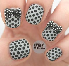 I like the dots and the gray/black combo, but those bows... Yuck.