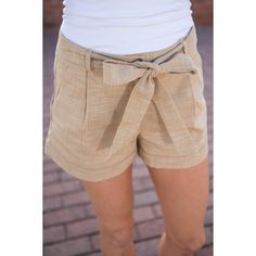 Educated Guess Shorts, Tan (51 CAD) ❤ liked on Polyvore featuring shorts, stretch shorts, tailored shorts, stretchy shorts, tan shorts and bow shorts