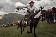 An ethnic Tibetan nomad performs skills during a riding competition at a local festival on July 26, 2015 on the Tibetan Plateau in Yushu County, Qinghai, China. Tibetan nomads face many challenges to their traditional way of life including politica...