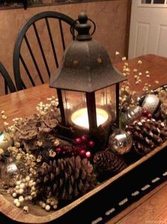 60 Most Popular Christmas Table Decoration Ideas. Decorating your table for Christmas can be as simple or as elaborate as you want to make it. But, there is one primary secret to Christmas table decor. Diy Christmas Decorations, Christmas Table Centerpieces, Lantern Centerpieces, Centerpiece Ideas, Coffee Table Christmas Decor, Christmas Coffee, Christmas Lanterns, Christmas Island, Vintage Christmas Decorating
