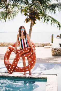 This beb has summer written all over her! Loving the one piece swimsuit and the pretzel pool float! We would so rather be hanging out at the pool than in the office working during summer!